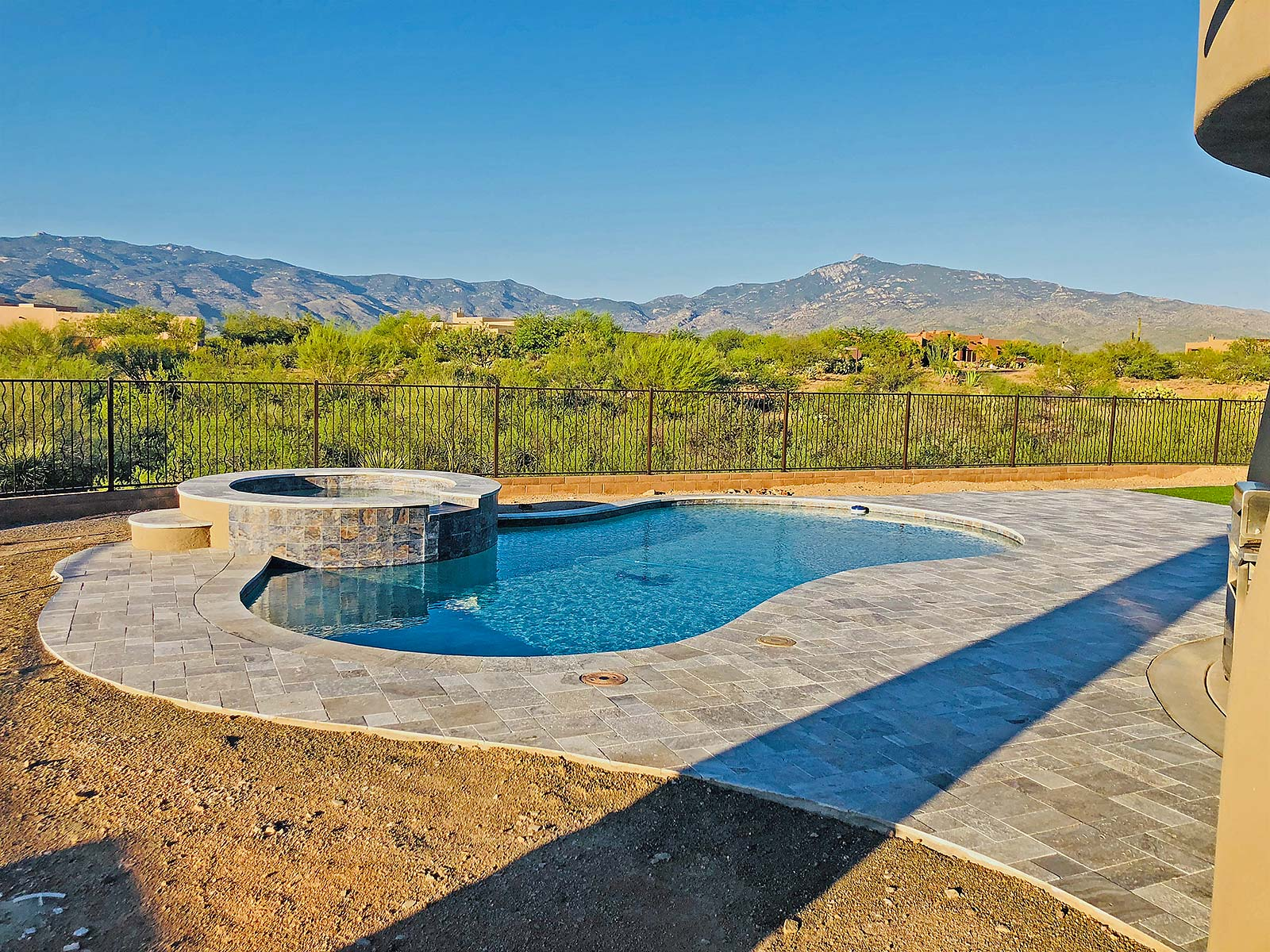 custom swimming pool installation and pavers